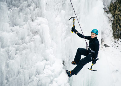 women climbed a frozen waterfall, icicle